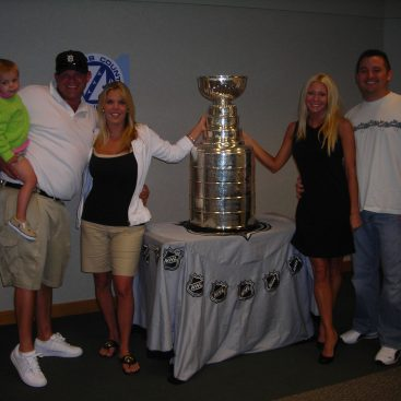 Go Red Wings! - Carey and her Husband Mike with their good friends Leo and Kelly Salvaggio and their Son Nino posing