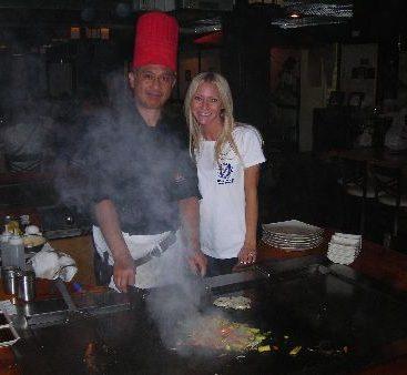 Osaka Restaurant - Carey helps Rolando cook on a hibachi grilll at the Osaka Restaurant