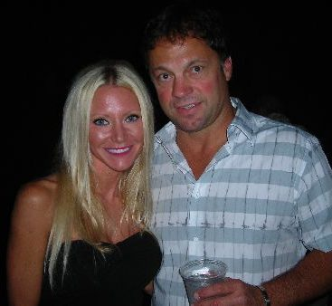 Carey with Dino Cicarelli - Carey is shown with former Detroit Red Wings Dino Cicarelli at Club 22. Dino opened the club about a year ago.