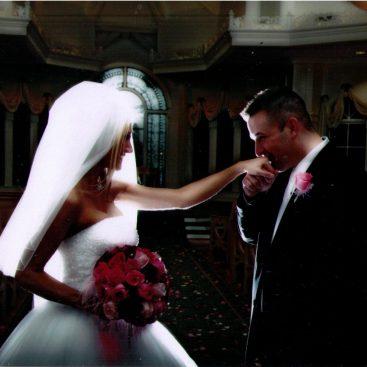 Disney World wedding - Mike kisses Carey's hand