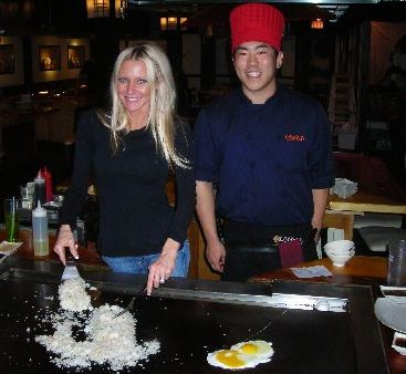 Osaka Japanese restaurant - Carey is taught how to cook fried rice by Chris. The restaurant is located on Hall road