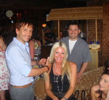 Carey with Ken Paves - The fabulous Ken Paves brushes the Commissioners hair at a posh Hollywood party in Michigan.  Ken Paves owns a salon right in Clinton Twp.