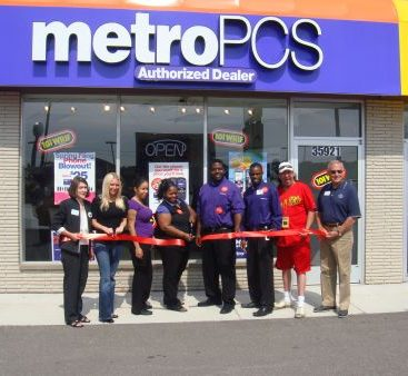 Grand Opening of Metro PCS - Carey Torrice attends a ribbon cutting in Clinton Twp. with Screamin Scott Randall from the Wrif.