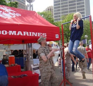 In memory of her USMC Father - Torrice is built Marine tough!  Carey does a chin-up for over 50 seconds and out lasts all the competition.